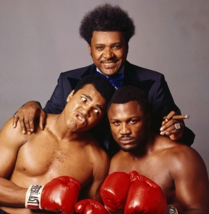 Portrait of promoter Don King with Muhammad Ali and Joe Frazier during their WBC/ WBA World Heavyweight Title fight preview photo shoot at Life Studios.  New York, New York 8/25/1975 (Image # 1097 )