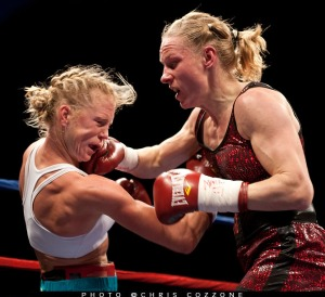 Dec. 2, 2011, Albuquerque, N.M.:  Establishing herself as the pound-for-pound queen of women's boxing and the top welterweight in the world, Anne Sophie Mathis (26-1, 22 KOs, of France, scored the upset of the year in female fighting by knocking out Albuquerque's Holly Holm (30-2-3, 9 KOs), tonight at Route 66 Casino, west of Albuquerque, N.M. at 1:38 of the seventh.