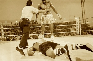 Referee Carlos Padilla pushes Thomas Hearns to a neutral corner after Hearns decked Roberto Duran during second round of their bout, June 15, 1984 in Las Vegas. Hearns won on a TKO in the WBC super welterweight championship. (AP Photo)