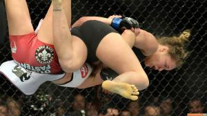 Ronda-Rousey-flying-yellow-feet