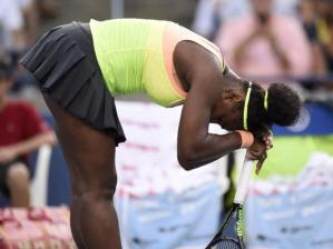 Serena Williams, of the United States, leans on her racquet as she plays Belinda Bencic, of Switzerland, during Rogers Cup semi-final tennis action in Toronto on Saturday, August 15, 2015. THE CANADIAN PRESS/Frank Gunn