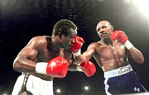 """Marvin Hagler middle weight boxer, right, in action versus John """"the Beast"""" Mugabe on March 10, 1986. Hagler won the bout with an 11th round knockout.  (AP Photo)"""