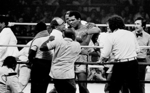 Muhammad Ali is in the ring surrounded by his trainers, handlers and doctors after winning in the 14th round against Joe Frazier at the Coiseum in Manila, Oct. 1, 1975. (AP Photo)