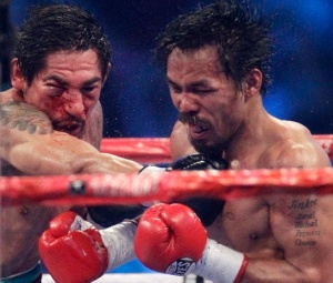 Manny Pacquiao, right, and Antonio Margarito, left, exchange blows during the 11th round of their WBC light middleweight title boxing match Saturday, Nov. 13, 2010, in Arlington, Texas. Pacquiao won by unanimous decision. (AP Photo/LM Otero)