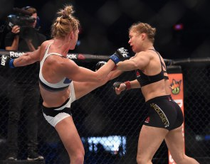 Nov 15, 2015; Melbourne, Australia; Ronda Rousey (red gloves) competes against Holly Holm (blue gloves) during UFC 193 at Etihad Stadium. Mandatory Credit: Matt Roberts-USA TODAY Sports ORG XMIT: USATSI-256554 ORIG FILE ID:  20151114_jel_rb8_093.jpg