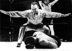 ** FILE ** Joe Louis lies on the canvas after being knocked out by Max Schmeling, rear, in this file picture taken June 19, 1936 in New York.  Schmeling has died Wednesday Feb. 2, 2005 aged 99, the Max Schmeling Foundation announced Friday Feb. 4, 2005. (AP Photo)