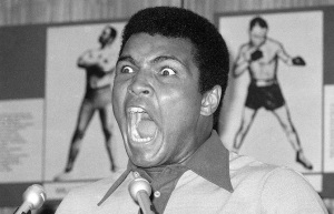 FILE - In this Aug. 29, 1974, file photo, boxer Muhammad Ali makes a face during a press luncheon in New York, to promote the sale of tickets to Madison Square Garden where the battle against George Foreman in Zaire will be shown in October on closed circuit television. Ali turns 70 on Jan. 17, 2012. (AP Photo/Ron Frehm, File)