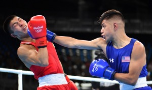 USA's Carlos Zenon Balderas Jr. (R) lands a punch on Kazakhstan's Berik Abdrakhmanov during the Men's Light (60kg) match at the Rio 2016 Olympic Games at the Riocentro - Pavilion 6 in Rio de Janeiro on August 6, 2016.   / AFP PHOTO / Yuri CORTEZYURI CORTEZ/AFP/Getty Images ORIG FILE ID: AFP_DX8O7