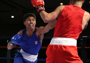 """FILE - In this Dec. 9, 2015, file photo, Shakur Stevenson, left, and Efren Lopez compete in the U.S. Olympic Boxing Trials in Reno, Nev. Shakur Stevenson doesn't flinch from the weight on his shoulders heading to Rio de Janeiro as the brightest candidate to win the first men's Olympic gold medal in 12 years from once-proud USA Boxing. After all, the teenager from Newark's mean streets was named after a rap great and practically raised in a boxing gym: """"I was born for this."""" (AP Photo/Cathleen Allison, File)"""