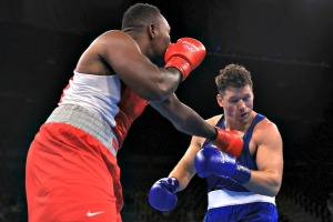 U.S.-Virgin-Islandss-Clayton-Laurent-Jr.-lands-a-punch-against-Erik-Pfeifer-of-Germany-in-the-men's-super-heavyweight-boxing-at-the-Riocentro-on-Tuesday-August-9-2016