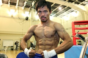 """Nov. 19, 2014, Macau, China    ---  """"RE-FLEXING ON ALGIERI """"  --   Superstar Manny Pacquiao flexes  during his final day of training on Wednesday of """"Fight Week"""" as he prepares for his upcoming championship fight against New York's undefeated (20-0) WBO Jr. Welterweight champion Chris """"Real Rocky"""" Algieri.          Promoted by Top RankÆ and Sands China Ltd., in association with MP Promotions, Joe DeGuardia's Star Boxing, Banner Promotions and Tecate, the Pacquiao vs. Algieri world welterweight championship event will take place Saturday, November 22, at the Cotai Arena in The Venetian Macao Resort in Macau,China.  It will be produced and distributed live by HBO Pay-Per-View beginning at 9:00 p.m. ET / 6:00 p.m. PT.      ----    Photo Credit : Chris Farina - Top Rank (no other credit allowed) copyright 2014"""