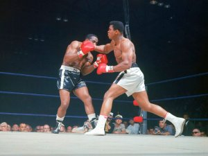 "Ali and, aka Muhammad Ali (R) throwing the famous ""phantom punch"" during his 2nd fight vs. Sonny Liston (L)"