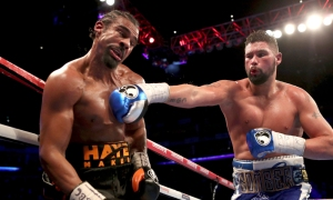 Britain's Tony Bellew, right, sends a right to his countryman David Haye during their heavyweight contest at the O2 Arena in London Saturday, March 4, 2017. Bellew knocked out Haye in the 11th round. (Nick Potts/PA via AP) ORG XMIT: TKTT805